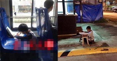 Bé trai 9 tuổi làm bài tập trên xe buýt gây tranh cãi
