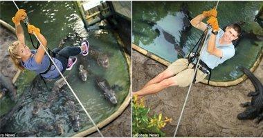 Sở thú hút khách bằng trò đu dây qua một hồ đầy... cá sấu