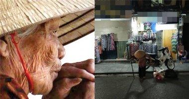 Nghẹn lòng cụ già lủi thủi đội nón đi giữa phố Hà Nội