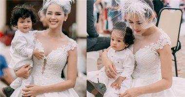 Á hậu Diễm Châu tái xuất trên sàn catwalk cùng con trai 1 tuổi