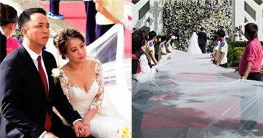 Chiếc khăn voan đội đầu cô dâu dài... 6 km trong siêu đám cưới gây sốt