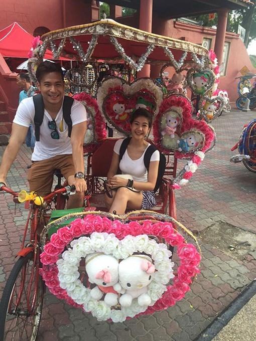 Trương Thế Vinh và bạn gái đang đi du lịch ở Malaysia. Anhphủ nhận hoãn đám cưới với bạn gái phi công. - Tin sao Viet - Tin tuc sao Viet - Scandal sao Viet - Tin tuc cua Sao - Tin cua Sao