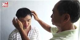 Nỗ lực của người cha ngày ngày giúp con chiến thắng bệnh Down