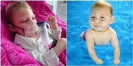 Hi hữu bé gái 2 tuổi không thể đi-như-người nhưng lại bơi-như-cá